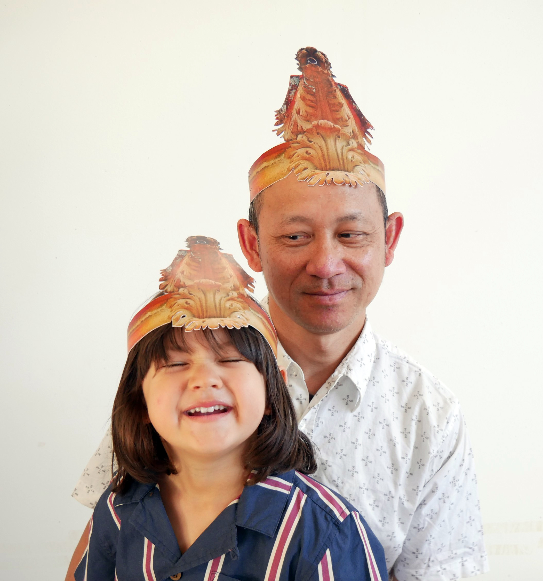 Somchai and Charlie wearing party hats